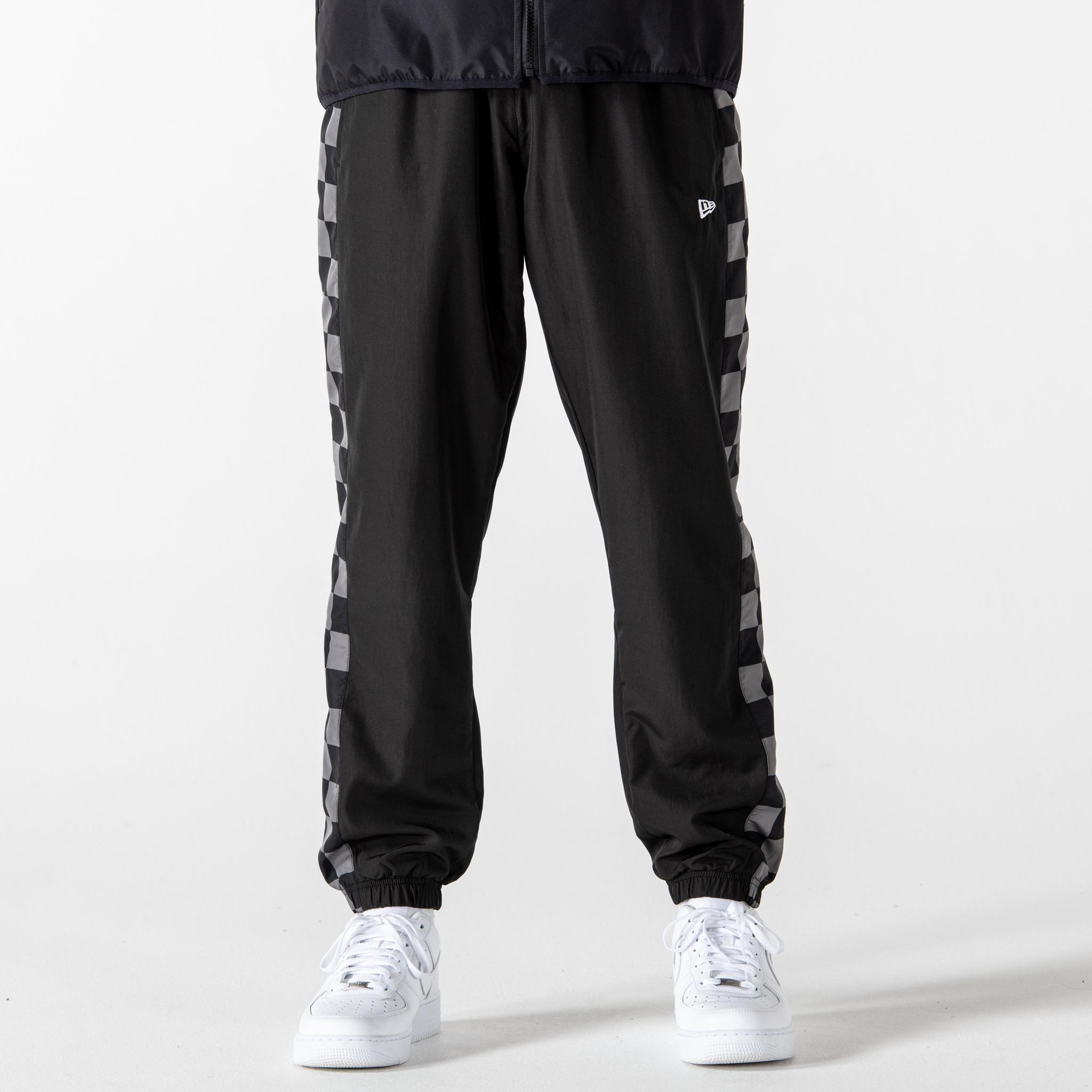 Pantalon de jogging noir à panneaux à carreaux New Era